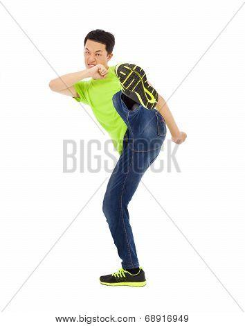 Young Man Raise Leg To Kick. Kong Fu Concept