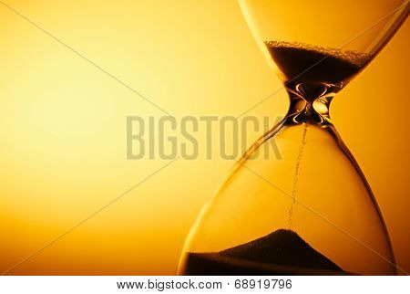 Sand Passing Through The Bulbs Of An Hourglass