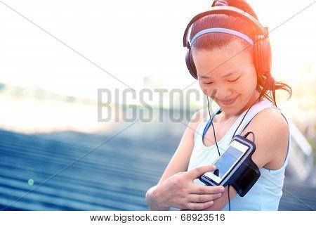 Runner athlete listening to music i