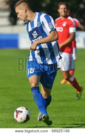 MOSCOW, RUSSIA - JULY 22, 2014: Aleksandar Cavric of OFK, Serbia in the match against Benfica, Portugal during the Lev Yashin VTB Cup, the international tournament for U21 soccer teams. OFK won 1-0