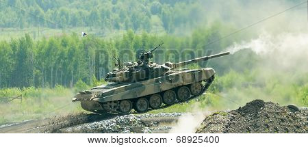 Shooting tank T-80 jumping in motion