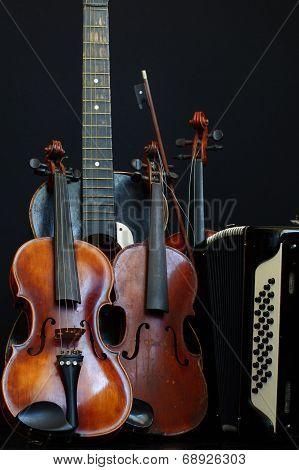 violin guitar and accordion still life