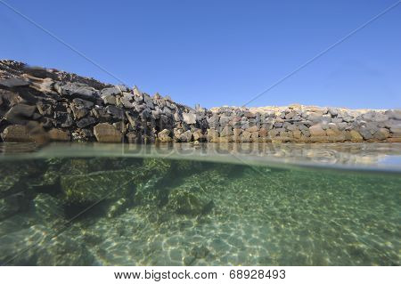 Stony Seawall In Tropical Lagoon