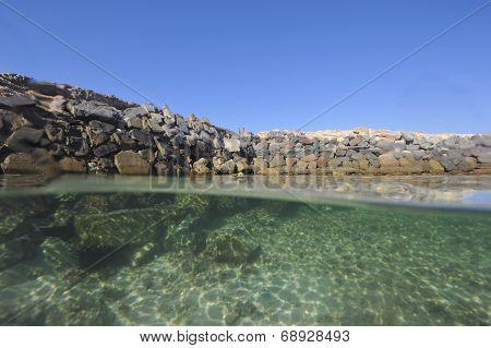 Stony Seawall In Tropical Lagoon