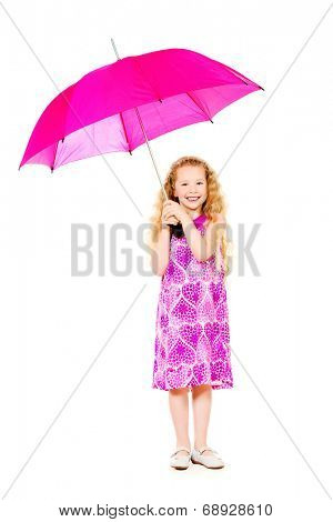 Beautiful smiling girl in a pink summer dress posing with a big pink umbrella. Isolated over white.