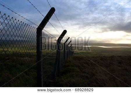 Barbed Wire Fencing And Scenic View