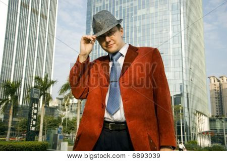 Businessman In Hat And Red Suit