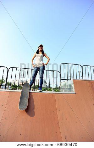 woman skateboarder at skatepark