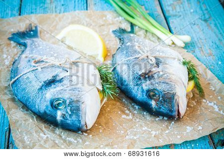 Two Raw Dorado Fishes With Lemon, Green Onions