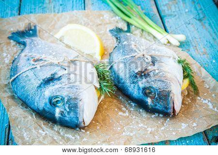 Two Raw Dorado Fishes With Lemon, Green Onions