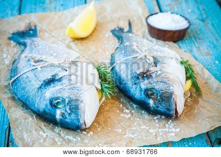 Two Raw Dorada Fishes With Lemon, Dill And Sea Salt