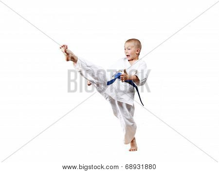 High kick leg in performance  sportsman with a blue belt
