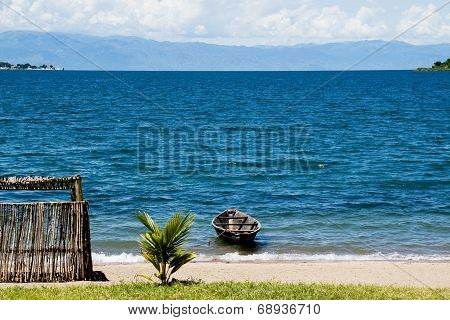 Lonely Boat next to a Shed on the Beach, Lake Tanganyika, Tanzania, Africa
