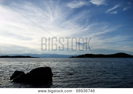 Sunset Sky with Silhouette of Rocks on Lake Tanganyika, Tanzania, Africa