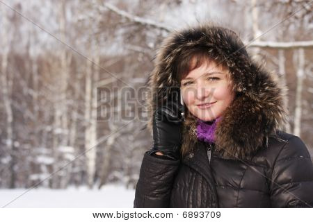 Smiling Woman On Phone In Frosty Day