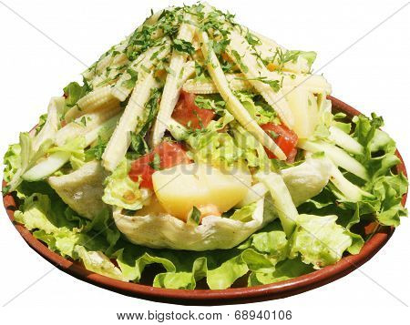 Taco salad with vegetables in freshly baked flour tortilla bowl