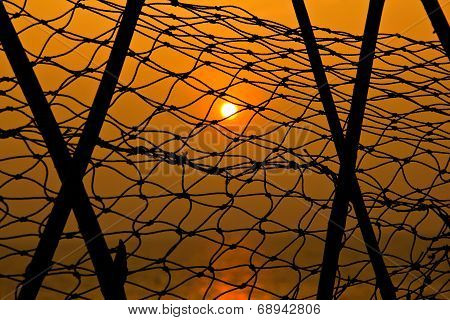 Sunset Through Fishnet.