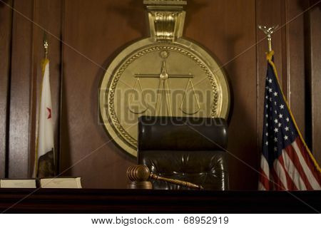 Closeup of judge's seat and gavel in court room