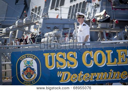 STATEN ISLAND, NY - MAY 25, 2014: A U.S. Navy officer walks down the metal gangplank of the guided-missile destroyer USS Cole (DDG 067) moored at Sullivans Piers for Fleet Week NY.