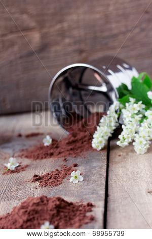 bird cherry flour with sifter on wooden table