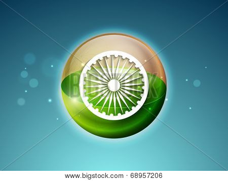 Shiny globe in saffron and green color with white asoka wheel on shiny blue background for Indian independence Day celebrations.