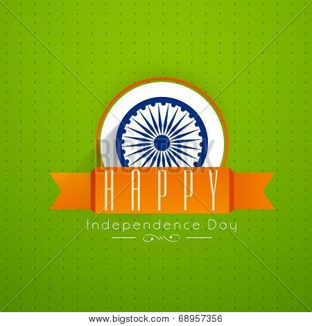 Beautiful sticky with Asoka Wheel and saffron color ribbon on green background with the message Happy Independence Day.