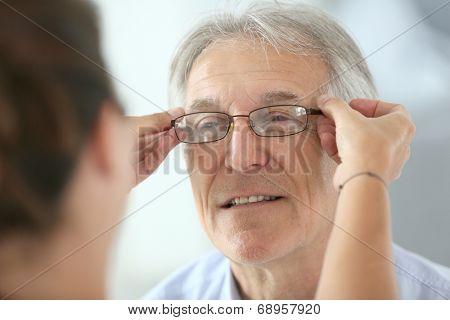 Senior man trying new eyeglasses