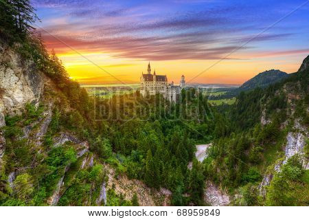 Neuschwanstein Castle in the Bavarian Alps at sunset, Germany