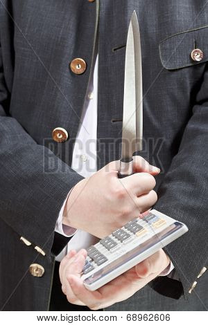 Calculator And Knife In Businessman Hands