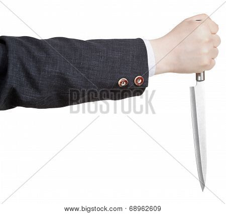 Side View Of Knife In Businessman Hand