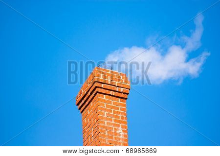 Brick Chimney Releasing Smoke On Sky.