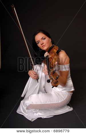 Young sexy woman with violin