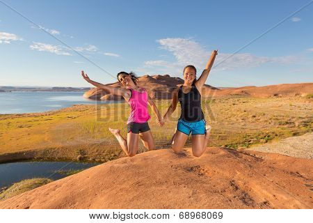 Two Pretty Girls Leaping For Joy