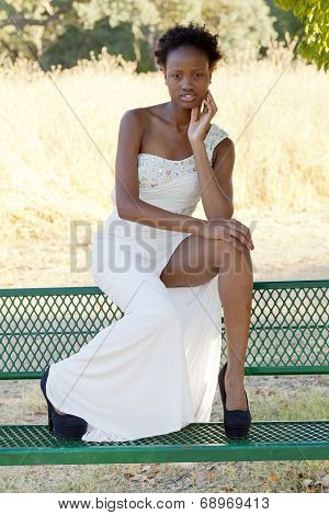 Attractive Black Teen Girl Dress Sitting Outdoors