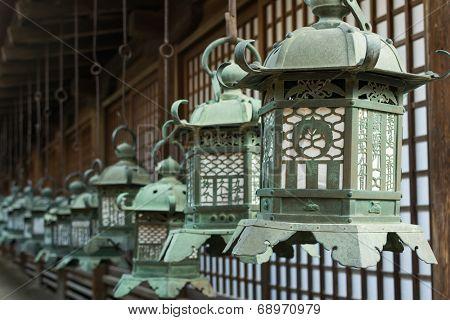 Japanese style bronze lantern hanging up in the shrine of  Kasuga Taisha in Nara, Japan.