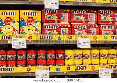 Selection Of Chocolate Candy M&m's On The Shelves In A Supermarket Siam Paragon In Bangkok.