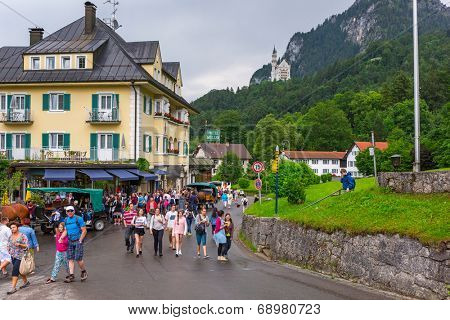 HOHENSCHWANGAU, GERMANY - 19 JUNE 2014: Tourists on the way to the Neuschwanstein Castle in Hohenschwangau, Germany. Hohenschwangau is a village located between two popular castles.