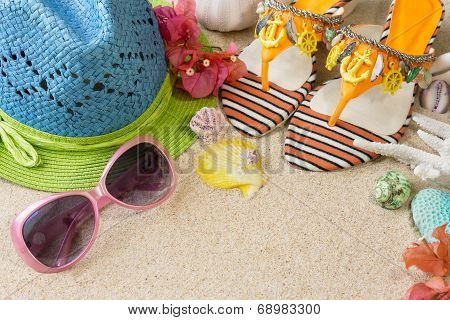 Sandals, Hat And Sunglasses On The Sand. Summer Beach Concept
