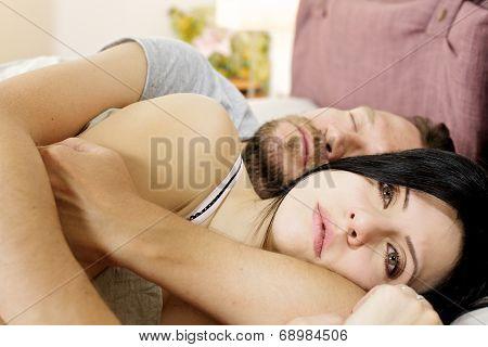 Sad Woman In Bed Hugged By Sleeping Husband