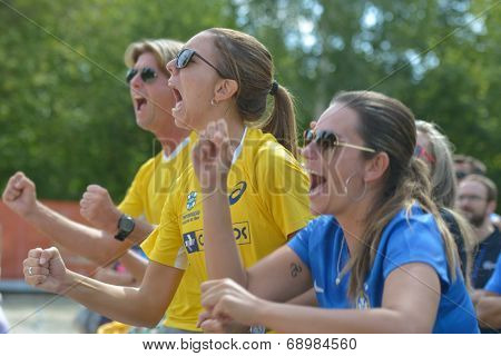 MOSCOW, RUSSIA - JULY 19, 2014: Brazil team supports the man double in the match against Spain during ITF Beach Tennis World Team Championship. Brazil won in two sets