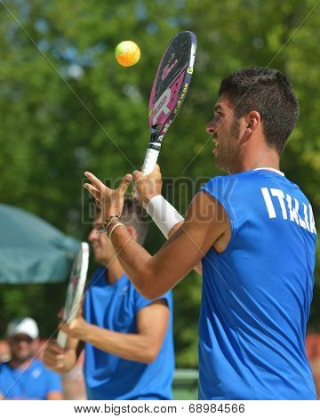 MOSCOW, RUSSIA - JULY 18, 2014: Men double of Italy in the match against France during ITF Beach Tennis World Team Championship. Italy won in two sets