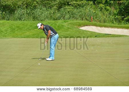 TSELEEVO, MOSCOW REGION, RUSSIA - JULY 24, 2014: Poom Saksansin of Thailand in action during the M2M Russian Open. This international golf tournament is the stage of the European Tour
