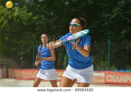 MOSCOW, RUSSIA - JULY 18, 2014: Federica Bacchetta (in front) and Sofia Cimatti of Italy in the match against France during ITF Beach Tennis World Team Championship. Italy won in two sets