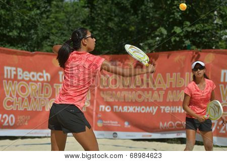 MOSCOW, RUSSIA - JULY 18, 2014: Woman double of China in the match against Greece during ITF Beach Tennis World Team Championship. Greece won in two sets