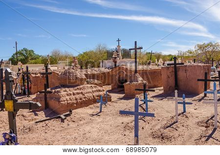 SAN PEDRO DE ATACAMA, CHILE, MAY 18, 2014 - Local cemetery with clay tombs and crosses