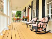 image of potted plants  - Low angle view of a large front porch with furniture and potted plants - JPG