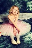 picture of tutu  - Pretty little girl ballerina in tutu posing over vintage background - JPG