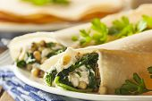 stock photo of crepes  - Delicious Homemade Savory French Crepes with Spinach and Feta - JPG