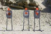 pic of shooting-range  - Three targets with bullet holes at firing range - JPG