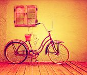 stock photo of planters  - a vintage bike with retro shutters toned with a warm instagram filter - JPG